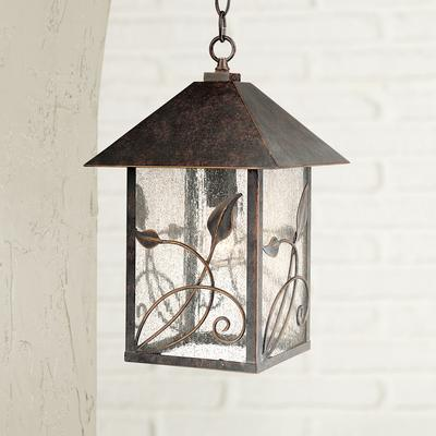 SB: French Garden 15  High Bronze Outdoor Hanging Light Bring the charm of a country garden to your porch or patio with this outdoor hanging light from Franklin Iron Works. This traditional lantern-style lamp comes in a bronze finish frame with seeded glass panels for a lovely old-fashioned look. A...